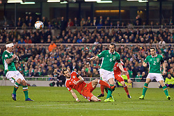 DUBLIN, REPUBLIC OF IRELAND - Friday, March 24, 2017: Wales' Gareth Bale tackles Republic of Ireland's John O'Shea, and is shown a yellow card ruling him out of the next fixture, during the 2018 FIFA World Cup Qualifying Group D match at the Aviva Stadium. (Pic by David Rawcliffe/Propaganda)