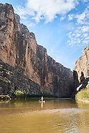 Stand up paddle boarding the Rio Grande River in Santa Elena Canyon, Big Bend National Park, Texas.