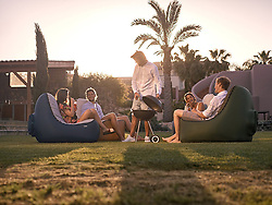 August 22, 2017 - inconnu - An inflatable chair for the beach, camping and music festivals does not need to be pumped up – just waved in the air.To get the Trono ready for use, all the user need to do is hold the mouth wide open, take a couple of steps until it fully inflates and seal it .The process should take no more than 10 seconds according to the manufacturer.When fully inflated, the Trono looks like a bean bag lounger.It has a deep and wide seat and high back rest.Construction is triple-coated nylon for the chair with double-stitched seams.It comes with a water-repellent suede cover that zips along the edges of the resting sections to serve as a seating surface. Trono isn't designed to stay inflated for an entire day. It slowly loses air as time passes requiring a refill after four hours.When packed into its carrying bag, the chair weighs 77 grams / 1.7 pounds, all while supporting up to 150 kilos / 330 pounds when inflated.The chair costs around $60 USD / €50 Euros / £46 GBP # FAUTEUIL GONFLABLE (Credit Image: © Visual via ZUMA Press)