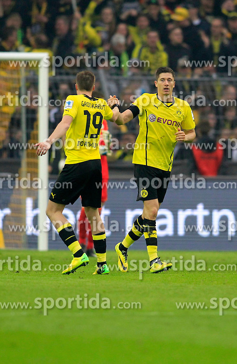 05.04.2014, Signal Iduna Park, Dortmund, GER, 1. FBL, Borussia Dortmund vs VfL Wolfsburg, 29. Runde, im Bild Kevin Grosskreutz (Borussia Dortmund #19) und Torschuetze Robert Lewandowski (Borussia Dortmund #9) beim Torjubel nach dem Treffer zum 1:1 Ausgleich mit Luiz Gustavo (VfL Wolfsburg #22) // during the German Bundesliga 29th round match between Borussia Dortmund and VfL Wolfsburg at the Signal Iduna Park in Dortmund, Germany on 2014/04/05. EXPA Pictures &copy; 2014, PhotoCredit: EXPA/ Eibner-Pressefoto/ Schueler<br /> <br /> *****ATTENTION - OUT of GER*****