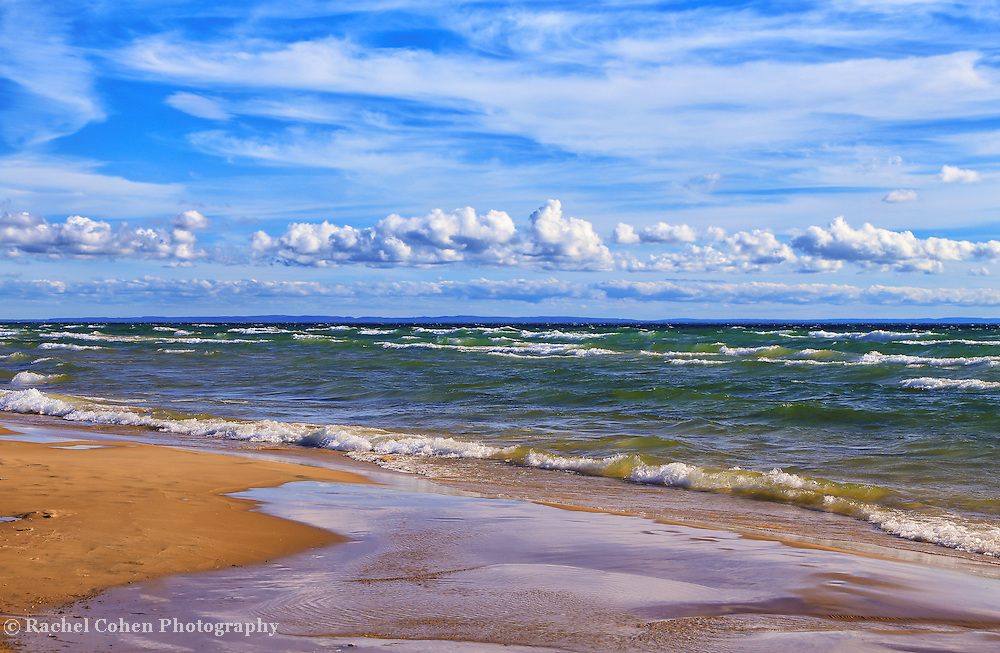&quot;The Clouds Go Marching&quot; 2<br /> <br /> Wonderful puffy low clouds and wispy high clouds grace the blue sky over scenic Lake Michigan's vast shoreline!!<br /> <br /> The Great Lakes by Rachel Cohen