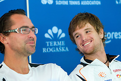 Coach Blaz Trupej with player Blaz Kavcic at press conference of Slovene Tennis Association after Slovenia defeated Lithuania  and qualified for Davis Cup Europe/Africa Group I , on September 20, 2010,  in TC Ljubljana Siska, Slovenia.  (Photo by Vid Ponikvar / Sportida)