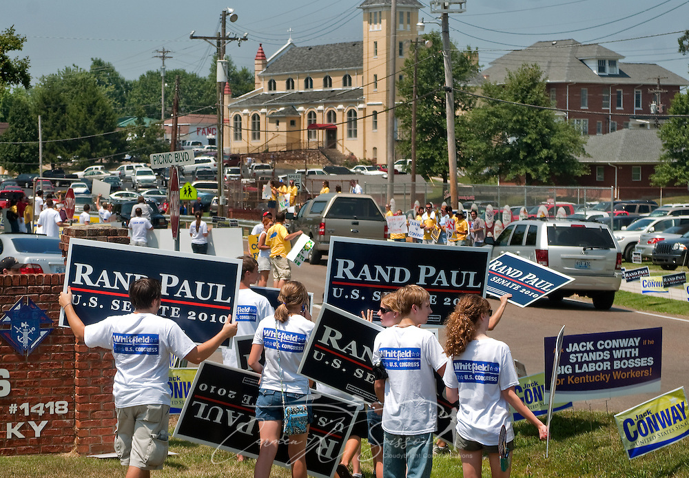 Supporters of Republican Senate candidate Rand Paul line the road Aug. 7, 2010 at the 130th annual Fancy Farm picnic and political rally in Fancy Farm, Ky. Paul, along with his opponent, Democrat Jack Conway, spoke at the picnic, which is held by St. Jerome Catholic Church, seen in the background. (Photo by Carmen K. Sisson/Cloudybright)