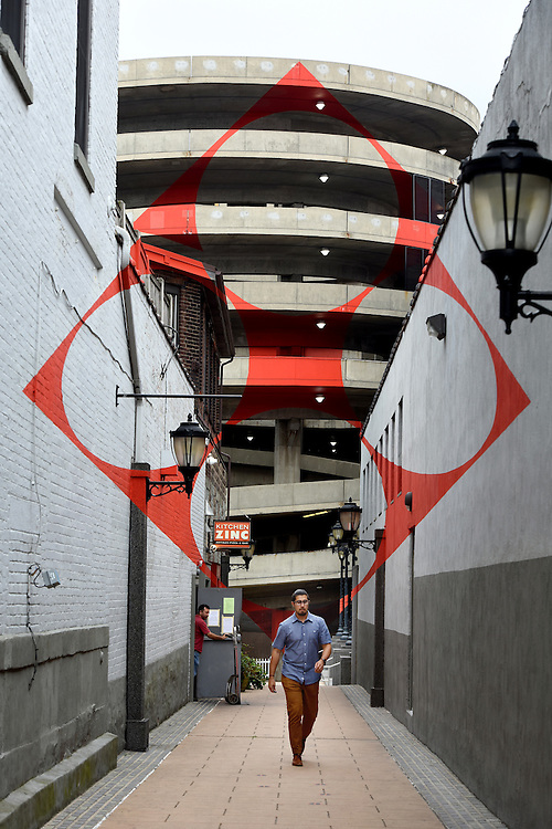 "Photo by Mara Lavitt -- Special to the Hartford Courant<br /> August 25, 2015 <br /> A new app is available to find public art in New Haven including ""Square with four circles"" by Felice Varini in a passageway off Chapel St."