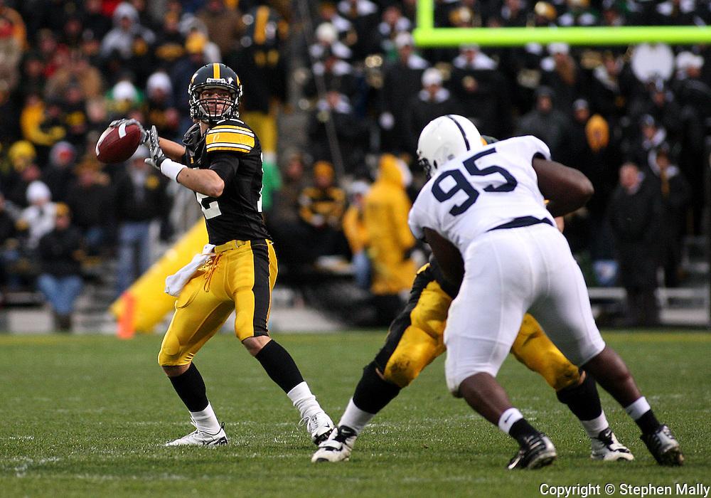08 NOVEMBER 2008: Iowa quarterback Ricky Stanzi (12) throws a pass in the second half of an NCAA college football game against Penn State, at Kinnick Stadium in Iowa City, Iowa on Saturday Nov. 8, 2008. Iowa beat Penn State 24-23.
