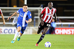 Peterborough United's Paul Taylor in action with Brentford's Toumani Diagouraga - Photo mandatory by-line: Joe Dent/JMP - Tel: Mobile: 07966 386802 08/10/2013 - SPORT - FOOTBALL - London Road Stadium - Peterborough - Peterborough United V Brentford - Johnstone's Paint Trophy