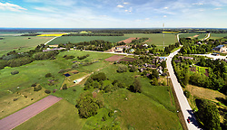Puhja village, settlement. Aerial view, landscape, roadside buildings in Estonia.