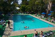 Swimming and relaxing in the pool area of historic Sportsman's Lodge in Studio City, Los Angeles.