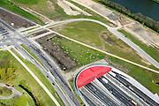 Nederland, Utrecht, Utrecht, 09-04-2014; Rijksweg A2 en de noordelijke ingang van de Leidsche Rijntunnel, een landtunnel die de verkeersoverlast, luchtvervuiling en geluidsoverlast voor Utrecht en de Vinexwijk Leidsche Rijn moet verminderen. Rechts het Amsterdam-Rijnkanaal met de stad Utrecht. Stadsbaan links van de tunnel. Tussen kanaal en tunnel zijn de contouren zichtbaar van de oude A2.<br /> Roadway A2 and the southern entrance to the tunnel Leidsche Rijn, a landtunnel built to decrease the nuisance of traffic noise and air pollution for the city of Utrecht and the suburb Leidsche Rijn . Right the Amsterdam-Rhine Canal and the city of Utrecht.<br /> luchtfoto (toeslag op standaard tarieven); aerial photo (additional fee required); copyright foto/photo Siebe Swart.