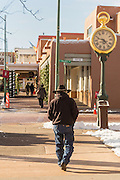 An old cowboy walks past the clock on the Santa Fe Plaza in the historic district December 14, 2015 in Santa Fe, New Mexico.