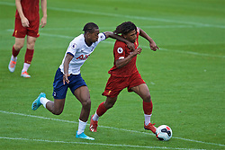 KIRKBY, ENGLAND - Saturday, August 10, 2019: Liverpool's Yasser Larouci (R) is pulled back by Tottenham Hotspur's Paris Maghoma during the Under-23 FA Premier League 2 Division 1 match between Liverpool FC and Tottenham Hotspur FC at the Academy. (Pic by David Rawcliffe/Propaganda)