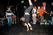 A boy break dancing, standing on his hands. UK B-Boy championships 06. 08/10/2006