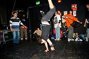 A boy break dancing, standing on his hands. UK B-Boy championships 06. 08/10/2006