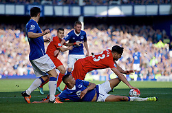 LIVERPOOL, ENGLAND - Sunday, October 4, 2015: Liverpool's Emre Can in action against Everton's Brendan Galloway during the Premier League match at Goodison Park, the 225th Merseyside Derby. (Pic by Lexie Lin/Propaganda)