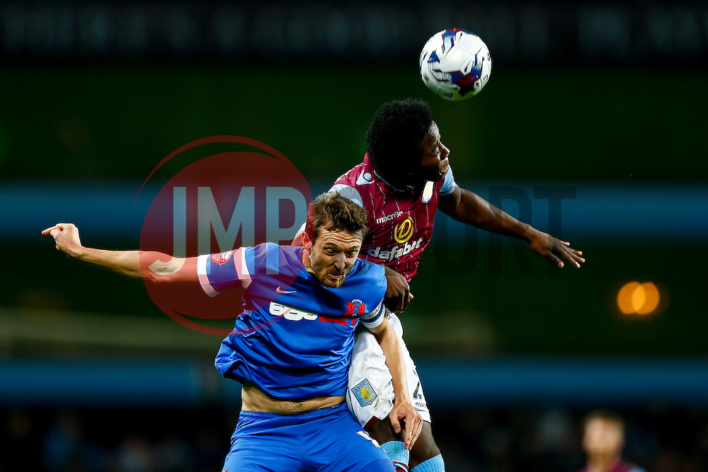 David Mooney of Leyton Orient and Carlos Sanchez of Aston Villa compete in the air - Photo mandatory by-line: Rogan Thomson/JMP - 07966 386802 - 27/08/2014 - SPORT - FOOTBALL - Villa Park, Birmingham - Aston Villa v Leyton Orient - Capital One Cup Round 2.