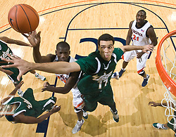Virginia guard/forward Mamadi Diane (24) shoots over South Florida center Alex Rivas Sanchez (11).  The Virginia Cavaliers defeated the South Florida Bulls 77-75 at the University of Virginia's John Paul Jones Arena in Charlottesville, VA on November 19, 2008.