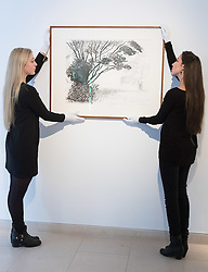 Christies, St James, London, March 4th 2016. Gallery assistants hang David Hockney's &quot;Kilham to Rudston&quot;, charcoal on paper from 2008 at the preview for the It&rsquo;s Our World charity auction at Christie's. Over 40 leading artists including David Hockney, Sir Antony Gormley, David Nash, Sir Peter Blake, Yinka Shonibare, Sir Quentin Blake, Emily Young and Maggi Hambling have committed artworks to the It&rsquo;s Our World Auction in support of The Big Draw and Jupiter Artland Foundation, to be sold at Christie&rsquo;s London on 10 March 2016.<br />  ///FOR LICENCING CONTACT: paul@pauldaveycreative.co.uk TEL:+44 (0) 7966 016 296 or +44 (0) 20 8969 6875. &copy;2015 Paul R Davey. All rights reserved.