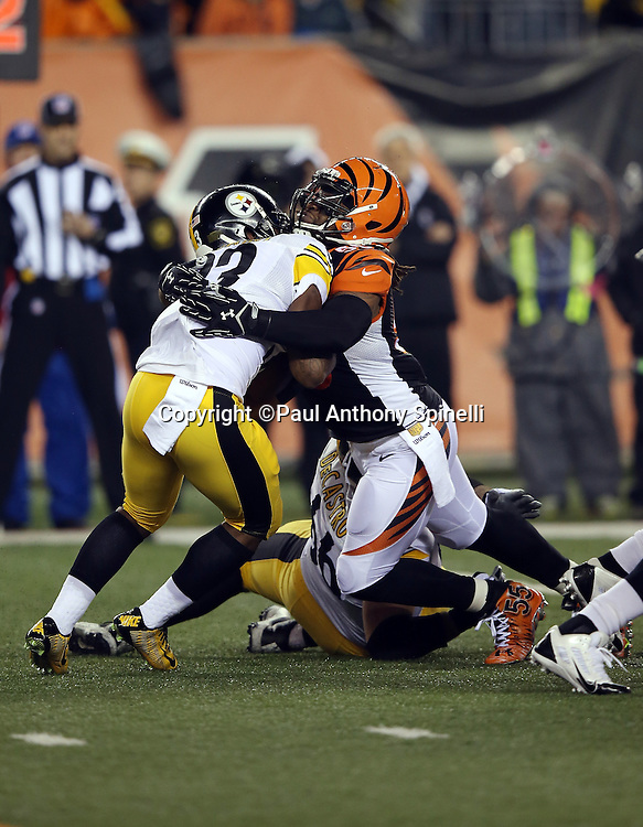 Cincinnati Bengals outside linebacker Vontaze Burfict (55) stuffs a first quarter run by Pittsburgh Steelers running back Fitzgerald Toussaint (33) during the NFL AFC Wild Card playoff football game against the Pittsburgh Steelers on Saturday, Jan. 9, 2016 in Cincinnati. The Steelers won the game 18-16. (©Paul Anthony Spinelli)