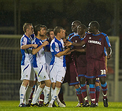 BRISTOL, ENGLAND - Tuesday, September 28, 2010: Tranmere Rovers' players and Bristol Rovers' players clash during the Football League One match at the Memorial Ground. (Photo by David Rawcliffe/Propaganda)