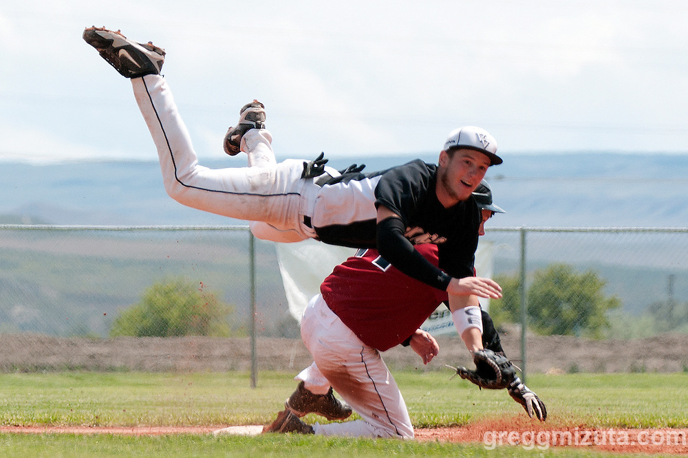 Vale Viking shortstop Kyle Barras attempts to turn two as he is leaps over Dayton's sliding JJ Jones during the quarterfinals playoff game on May 27, 2011 at Cammann Field, Vale, Oregon.