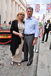 PHILIP LAWLESS owner of Motcoms and SUE LIBERMAN at a street party to celebrate HM The Queen Elizabeth 11 Diamond Jubilee held in Motcomb Street, London on 30th May 2012.