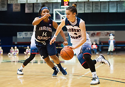 March 6 2016: Robert Morris Colonials guard Anna Niki Stamolamprou (4) drives to the basket past Fairleigh Dickinson Lady Knights forward Brianna Thomas (14) during the second half in the NCAA Women's Basketball game between the Fairleigh Dickinson Lady Knights and the Robert Morris Colonials at the Charles L. Sewall Center in Moon Township, Pennsylvania (Photo by Justin Berl)