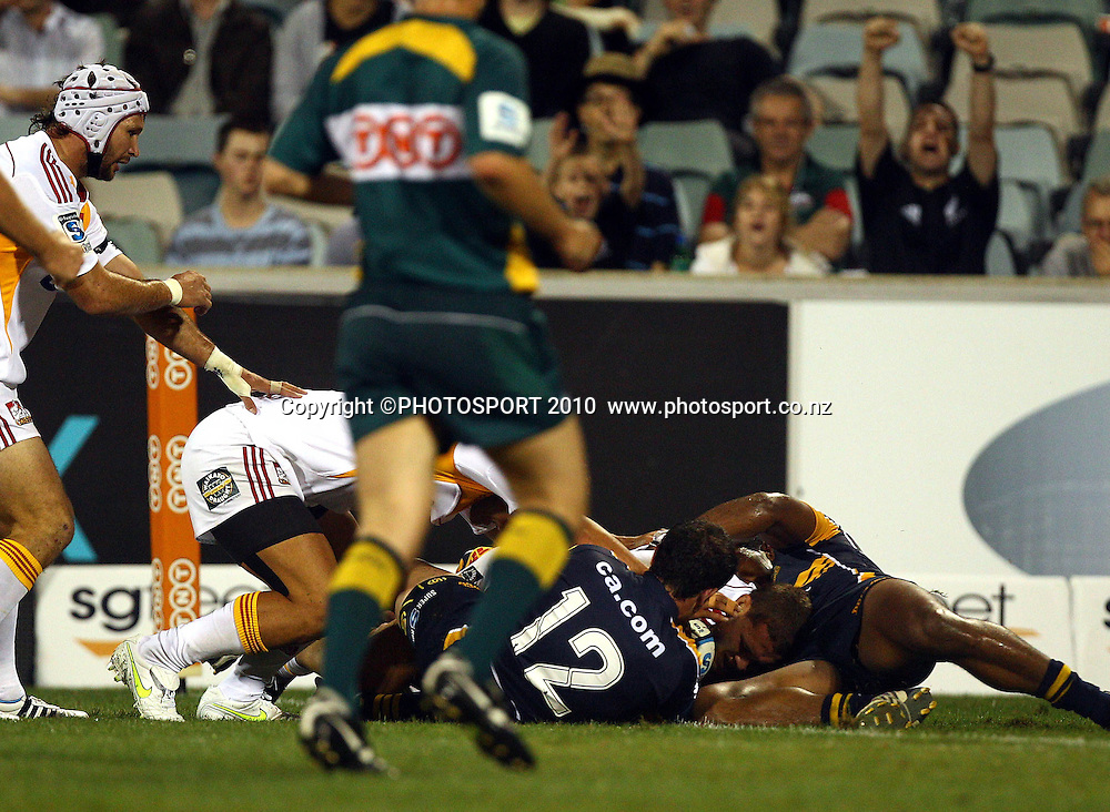 Tawera Kerr-Barlow kicks ahead to regather and score<br /> Super 14 rugby union match, Brumbies v Cheifs, Canberra, Australia. Saturday 19 February 2011. Photo: Paul Seiser/PHOTOSPORT