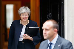 © Licensed to London News Pictures. 11/07/2017. London, UK. Prime Minister THERESA MAY leaves Downing Street to give a speech after a cabinet meeting in London on Tuesday, 11 July 2017. Photo credit: Tolga Akmen/LNP
