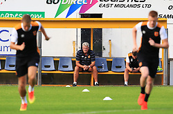 Hull City manager Steve Bruce looks thoughtful in the dugout as his players warm up - Mandatory by-line: Matt McNulty/JMP - 19/07/2016 - FOOTBALL - One Call Stadium - Mansfield, England - Mansfield Town v Hull City - Pre-season friendly