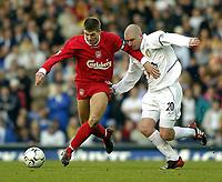 Photo. Jed Wee.<br /> Leeds United v Liverpool, FA Barclaycard Premiership, Elland Road, Liverpool. 29/02/2004.<br /> Liverpool's Steven Gerrard (L) holds off Leeds' Seth Johnson.