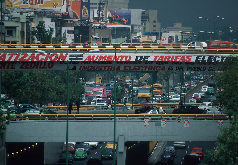 Mexico City's inner ring road, with advertising posters and political banners.