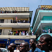 Downtown Monrovia fills up peacefully after the guilty verdict of former warlord and Liberian president, Charles Taylor, is announced in The Hague. Liberia, April 2012.