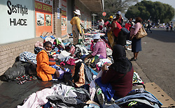 South Africa - Durban - 26 July 2020 - With the flea market closed, hawkers have taken to selling on the street to make ends meet. The women and men say that although they do not make as much money as they used to before what they do make is sufficientfor them to get by. Picture: Bongani Mbatha/African News Agency(ANA)