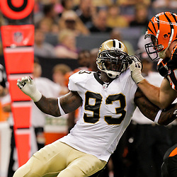 2009 August 14: New Orleans Saints defensive end Bobby McCray (93) works against Cincinnati Bengals offensive tackle Dennis Roland (74) during a preseason opener between the Cincinnati Bengals and the New Orleans Saints at the Louisiana Superdome in New Orleans, Louisiana.