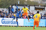 Anthony Stewart of Wycombe Wanderers and Lyle Taylor of AFC Wimbledon jump for the ball during the Sky Bet League 2 match between AFC Wimbledon and Wycombe Wanderers at the Cherry Red Records Stadium, Kingston, England on 21 November 2015. Photo by Stuart Butcher.