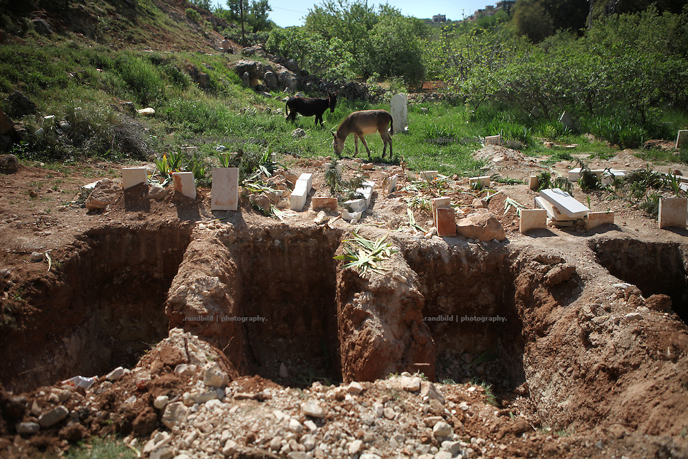 Fearing new attacks by Assads forces locals have digged new graves in advance. They experienced too often not to have time and ability to bury their deads in time so they decided to prepare the cemeteries when there is time to accomplish it. Seen in the Jabal Al-Zawiha area.