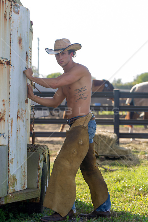 shirtless hot young cowboy with a horse trailer