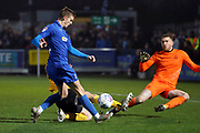 AFC Wimbledon attacker Marcus Forss (15) shoots and Southend United goalkeeper Mark Oxley (1) saves during the EFL Sky Bet League 1 match between AFC Wimbledon and Southend United at the Cherry Red Records Stadium, Kingston, England on 1 January 2020.