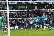 Josh Magennis with a diving header during the EFL Sky Bet Championship match between Derby County and Hull City at the Pride Park, Derby, England on 18 January 2020.