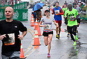 Publix Georgia Half Marathon participant Leslie Moore, of Auburn, Alabama, (8659) leads a pack of runners toward the finish line at Centennial Park on Sunday, March 22, 2015, in Atlanta. David Tulis / AJC Special