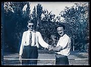 friends shaking hands during a sportive  tennis match France ca 1920s