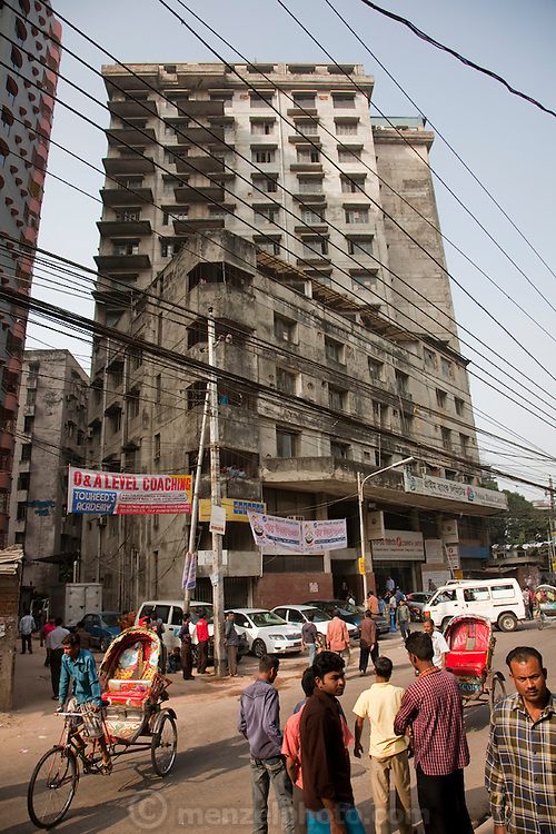 An outside view of the Ananta apparel factory on Elephant Road, downtown Dhaka, Bangladesh. While nearly half of Bangladesh's population is employed in agriculture, in recent years the economic engine of Bangladesh has been its garment industry, and the country is now the world's fourth largest clothing exporter, ahead of India and the United States. Dependent on exports and fearing international sanctions, Bangladesh's garment industry has implemented rules outlawing child labor and setting standards for humane working conditions.