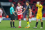 The Referee talks (Darren Bond) to Doncaster Rovers Forward John Marquis (9)  about his foul on Bristol Rovers Midfielder Stuart Sinclair during the EFL Sky Bet League 1 match between Doncaster Rovers and Bristol Rovers at the Keepmoat Stadium, Doncaster, England on 27 January 2018. Photo by Craig Zadoroznyj.