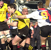 29/02/2004  -  Powergen  Cup - London Wasps v Pertemps Bees .Bees No. 9 Paul Knight, managed to get a hand on  John Rudds shoulder hoping to stop his run.   [Mandatory Credit, Peter Spurier/ Intersport Images].