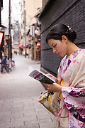A young lady renting a kimono, enjoying walking around Gion, Kyoto.