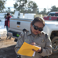 Ramah Police Officer Aileen Evens writes a report from an accident involving a truck at the Solid Waste Authority in Pinehill January 23.