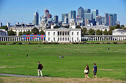 © Licensed to London News Pictures. 13/09/2018<br /> GREENWICH, UK.<br /> Queens house and Canary Wharf with blue sky.<br /> Sunny September weather in Greenwich Park, Greenwich.<br /> Photo credit: Grant Falvey/LNP