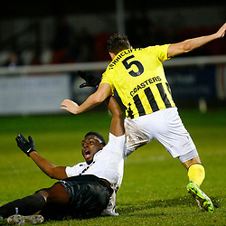 Dover's forward Inih Effiong is sent tumbling by AFC Fylde's defender Jordan Tunnicliffe during the National League match between Dover Athletic FC and AFC Flyde at Crabble Stadium, Kent on 08 December 2018. Photo by Matt Bristow.