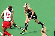 Gemma Flynn during the pool B women's hockey match of the The Commonwealth Games between New Zealand and Wales held at the Stadium in New Delhi, India on the  October 2010..Photo by:  Ron Gaunt/SPORTZPICS/PHOTOSPORT