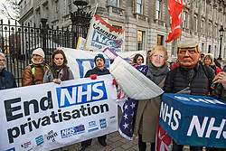 © Licensed to London News Pictures. 09/12/2019. London, UK. NHS workers and NHS patients hold a demonstration  outside Downing Street in Westminster calling for the NHS to be kept in public ownership. There have been claims that the NHS would be open to private ownership form foreign investment if the Conservatives win a majority in Thursday's  General Election. Photo credit: Ben Cawthra/LNP
